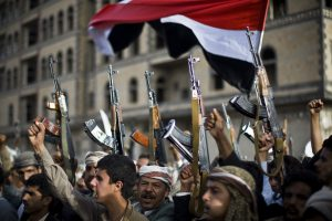 Shiite rebels, known as Houthis, hold up their weapons as they attend a protest against Saudi-led airstrikes in Sanaa, Yemen, Friday, April 10, 2015. Pakistani lawmakers on Friday unanimously voted to stay out of the Saudi-led air coalition targeting Shiite rebels in Yemen in a blow to the alliance, while planes loaded with badly needed medical aid landed in Yemen's embattled capital, Sanaa, in the first such deliveries since the airstrikes started more than two weeks ago. (AP Photo/Hani Mohammed)