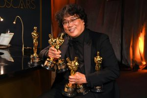 """Mandatory Credit: Photo by Richard Shotwell/Invision/AP/Shutterstock (10552687f) Bong Joon-ho holds the Oscars for best original screenplay, best international feature film, best directing, and best picture for """"Parasite"""" at the Governors Ball after the Oscars, at the Dolby Theatre in Los Angeles 92nd Academy Awards - Governors Ball, Los Angeles, USA - 09 Feb 2020"""