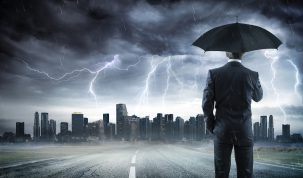 Business man With Umbrella Looking Storm Over City
